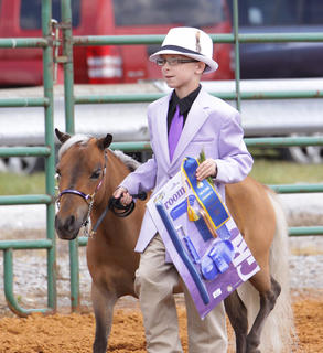 Lucas Thomas shows his horse, Cricket, during the Youth Horse Show on Saturday.