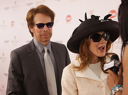 Movie director Jerry Bruckheimer and his wife, Linda, walk the red carpet at the Kentucky Derby.