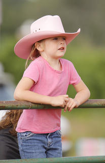 Maison Karnes, 6, of Columbia, watches participants during the Youth Horse Show at the fair on Saturday.