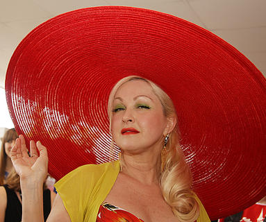 Cyndi Lauper shows off her hat as she walks the red carpet at the Kentucky Derby.