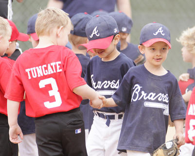 Players from the Braves and Angels shake hands after a hard-fought tee ball game at Miller Park.
