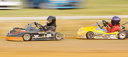 Drivers in the GoKart races at the Taylor County Fair make their way around the track.