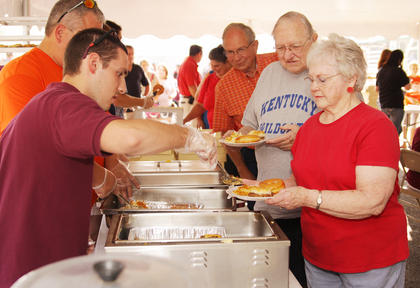 Shirley Winters of Campbellsville is served breakfast by Jacob Horn, a member of Campbellsville Christian Church.