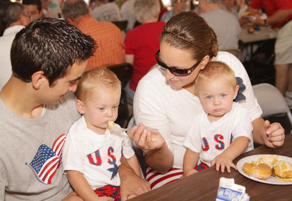 Jonathan and Diane Coomer feed their 21-month-old twins, Carter and Clay, at the Campbellsville Christian Church breakfast.