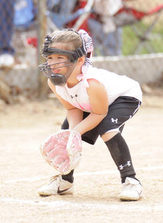 Autumn Brockman of the Thunder Bunnies is down and ready for action at third base as softball season begins at Trace Creek Saturday.