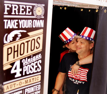 Curt and Courtney Clark enjoy some Fourth of July fun in a photo booth during the celebration in downtown Campbellsville.