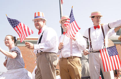"Members of the cast of ""The Music Man"" rode on a float  during the Fourth of July parade in Campbellsville."
