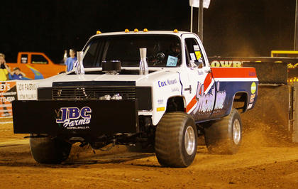 "Brandon Cox of Campbellsville competes in the Kentucky Truck Pulling Association event at the fair on Wednesday in his truck, ""Showtime."""