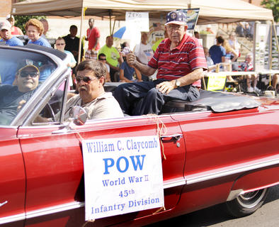 Conrad Claycomb, who was a prisoner of war in World War II, rode in the Fourth of July parade in Campbellsville.