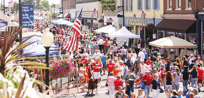 Large crowds make their way up and down Main Street during the Fourth of July festivities in Campbellsville.