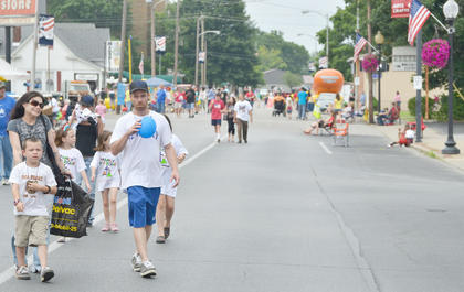 Though events were rained out on Thursday, residents were able to walk down Main Street on Wednesday and visit booths and attend events.