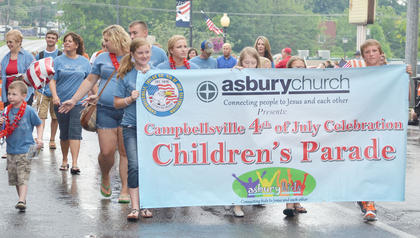 Asbury Church members kick off the annual Children's Parade on Wednesday night.