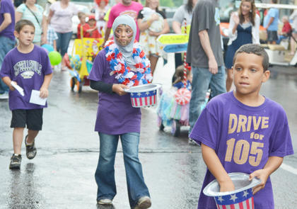 Campbellsville School System students pass out candy during the Children's Parade on Wednesday.