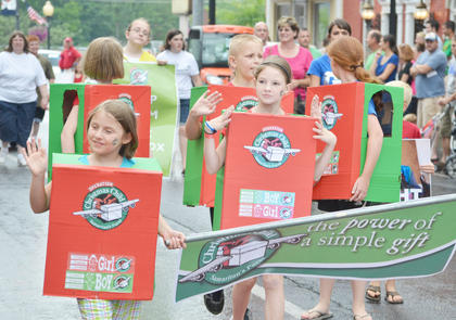 Children dressed as Operation Christmas Child boxes in the Children's Parade on Wednesday night.