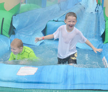 The inflatable slide, with a splash zone at the bottom, drew a large crowd at the Family Fun Zone on Wednesday night.