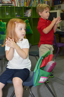 "KCA Sonbeams students Kyndall Southern, at left, and Cobe McVay clap along as they sing ""Twinkle, Twinkle Little Star."""