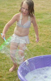 Madison Johnson, 5, of Campbellsville, plays with bubbles at the Family Fun Zone.