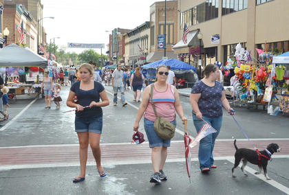 Taylor County residents weren't the only ones visiting the booths on Main Street on Tuesday night. Dogs came to check out the festivities, too.