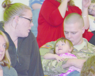 Staff Sgt. Chad Ubbelohde of Elizabethtown holds his daughter, Hannah, 10 months old, during Friday&#039;s ceremony.