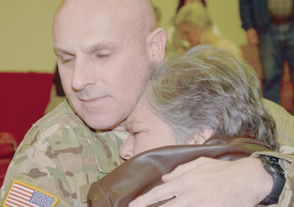 Sgt. 1st Class Michael Hovious, originally from Campbellsville, closes his eyes as he hugs his aunt, Diane Tucker, tightly as she tells him goodbye.