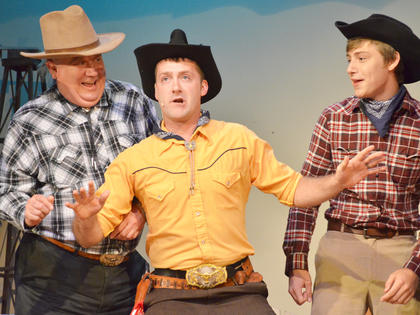 "Will Parker, portrayed by Campbellsville resident Chad Shively, sings during a performance of ""Oklahoma!"""
