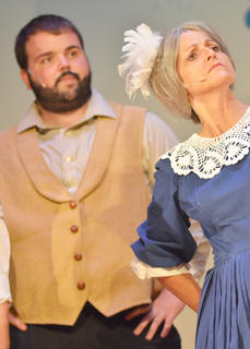 Jericho McCoy of Campbellsville portrays Jud Fry, at left, as Suzanne Bennett, formerly of Campbellsville, plays Aunt Eller.