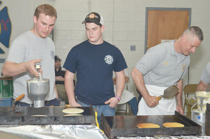 From left, Alex Quinn, Nick Penick and Campbellsville Fire & Rescue Chief Kyle Smith cook pancakes on Saturday morning.