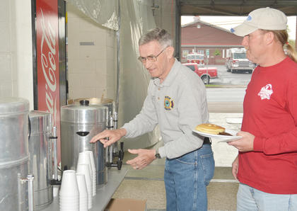 Randy Bricken Sr. mans the coffee station during Saturday's breakfast.