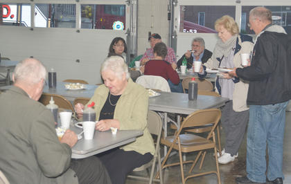 A large crowd came to eat at the annual breakfast.
