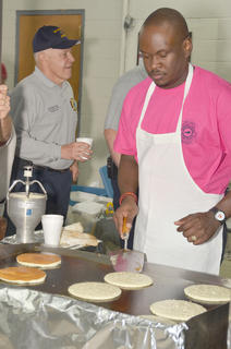 Arthur Pettigrew mans a pancake station on Saturday morning.