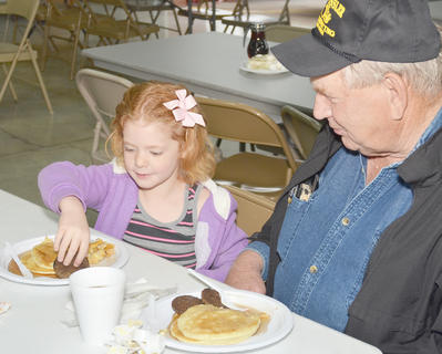 Chloe Motheral, 6, and her step-great-grandfather Bobby Kessler, of Campbellsville, take a bite of their breakfast.