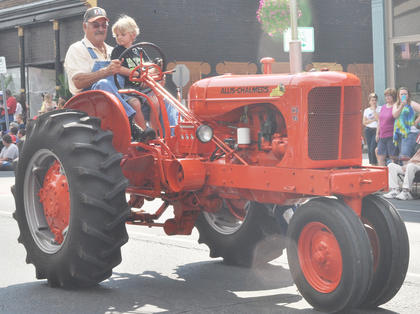 Tractors were a featured part of this year's parade. Many residents rode atop them with their children.
