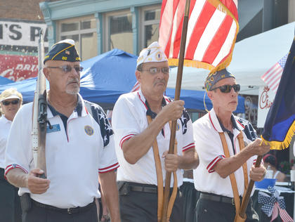 American Legion Post 82 members carry flags at the beginning of the parade down Main Street.