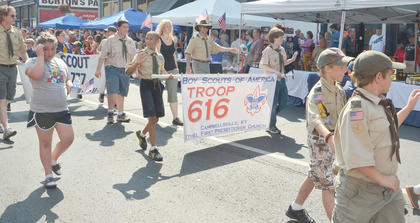 Area Boy Scouts and Cub Scouts walk in the parade.