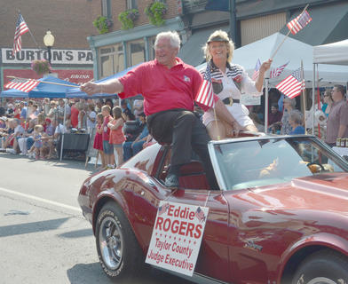 Taylor County Judge/Executive Eddie Rogers and his wife, Theresia, wave to the crowd.