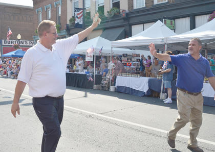 "State legislators Sen. Jimmy Higdon, R-Lebanon, at left, and Rep. John ""Bam"" Carney, R-Campbellsville, greet residents as the walk in the parade."