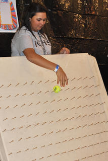 Samantha Buckman tries to score points while playing Plunko at TCHS Project Graduation on May 24.