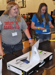 Erin Cox looks at several prizes available for the silent auction during TCHS Project Graduation on May 24.