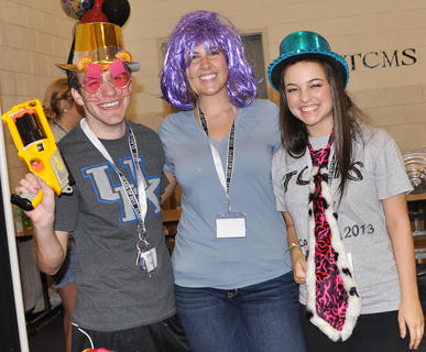 From left, Spencer Tungate, Hannah Sadler and Katie Long decide what to wear in the photo booth at TCHS Project Graduation on May 24.