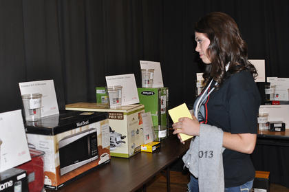 Haley Franklin looks at a microwave, one of the many prizes available for graduates at TCHS Project Graduation on May 24.