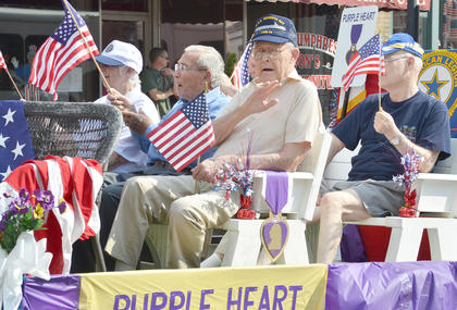 Local purple hart recipients wave to the crowd. Taylor County was recently named a Purple Heart City.
