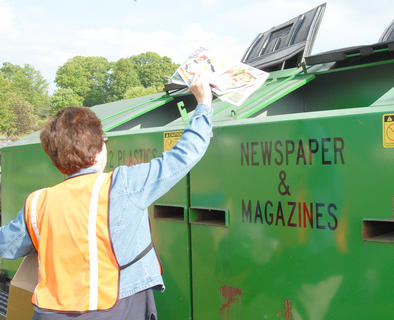 Taylor County Conservation District hosted a Recycling Day on Saturday, April 28, to encourage residents to recycle. Those who recycled received a free recycling container and two trees from the state&#039;s Division of Forestry. Above, Nancy Loyall of Campbellsville recycles some newspapers.
