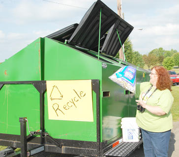 Taylor County Conservation District hosted a Recycling Day on Saturday, April 28, to encourage residents to recycle. Those who recycled received a free recycling container and two trees from the state&#039;s Division of Forestry. Above, Linda Russell of the Taylor County Conservation District puts some recyclables into one of several bins that are placed throughout Taylor County.