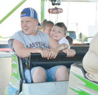 Children, teenagers and adults alike enjoy riding the midway rides at the fair.