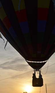 Taylor County residents take a ride in a hot air balloon at sunset.