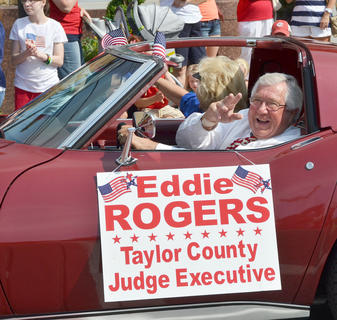 Taylor County Judge/Executive Eddie Rogers waves to the crowd.