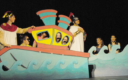 Odysseus, middle, portrayed by Ozzie Delgado, is tempted by two sirens to delay his homecoming even more.