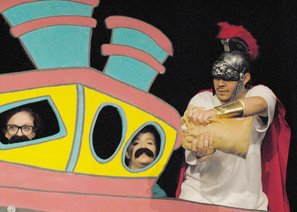 "Taylor County High School Drama presented ""SeussOdyssey"" last on May 4 and 5 at Campbellsville University's theater. The story mixed the classic version of ""The Odyssey"" with a twist of Dr. Seuss rhyming. Karen McAnelly and Dana Rogers directed the show. Erin Steele, at left, and Miranda Scott portray Crew Members 5 and 4, respectively, as Ozzie Delgado, who is portraying Odysseus, opens a bag of wind in hopes of sailing home soon."