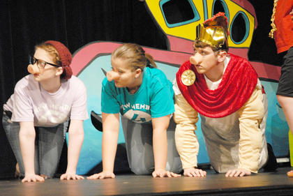 From left, Crew Member 5, played by Erin Steele, Crew Member 4, played by Miranda Scott and Ajax, played by Jacob Lee, are turned into pigs at Circe's party that lasted for years.