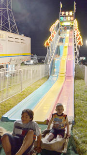 Children crash at the bottom of the Fun Slide.